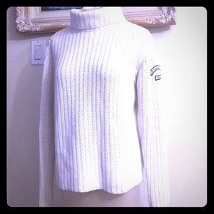 White cable knit turtleneck by Calvin Klein